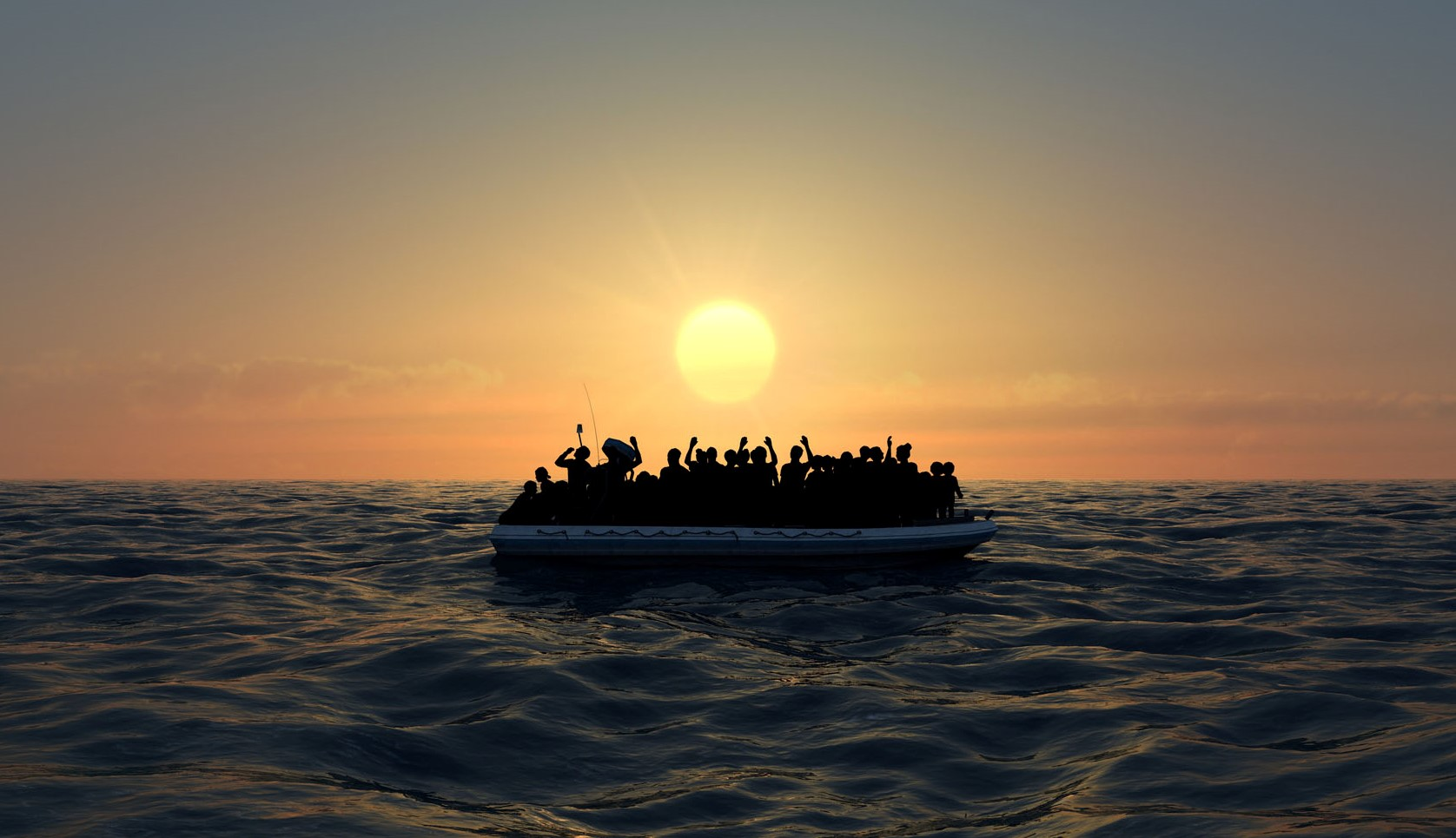 Refugees on a big rubber boat in the middle of the sea that require help